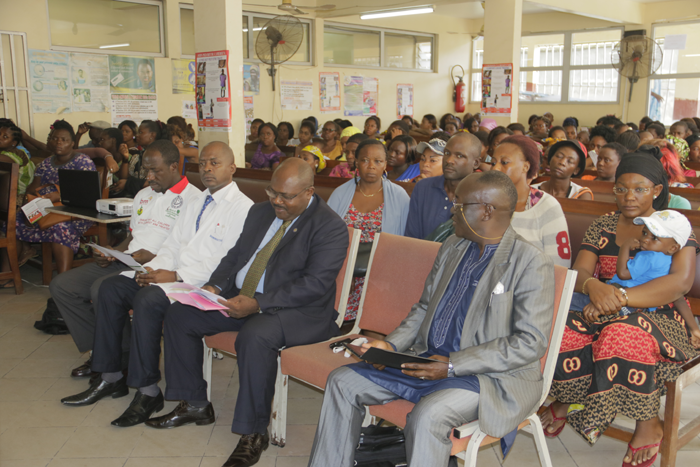 Cross section of officals and the audience listening to presentations