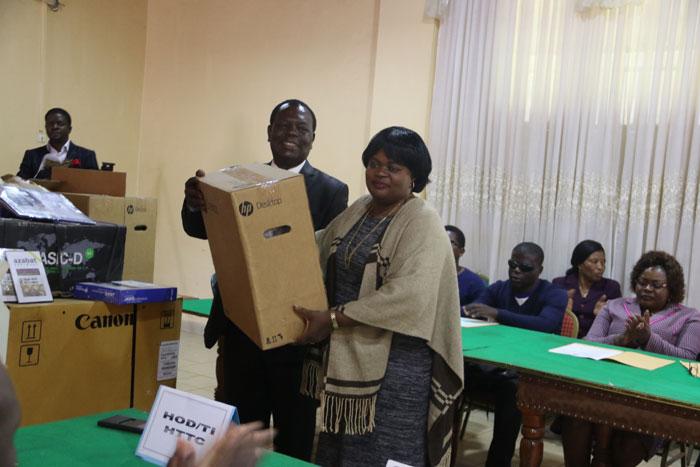 Prof Tih handing over equipment to the University of Bamenda