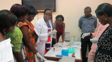 QIAGEN staff (in white) training WHP staff on use of CareHPV machine
