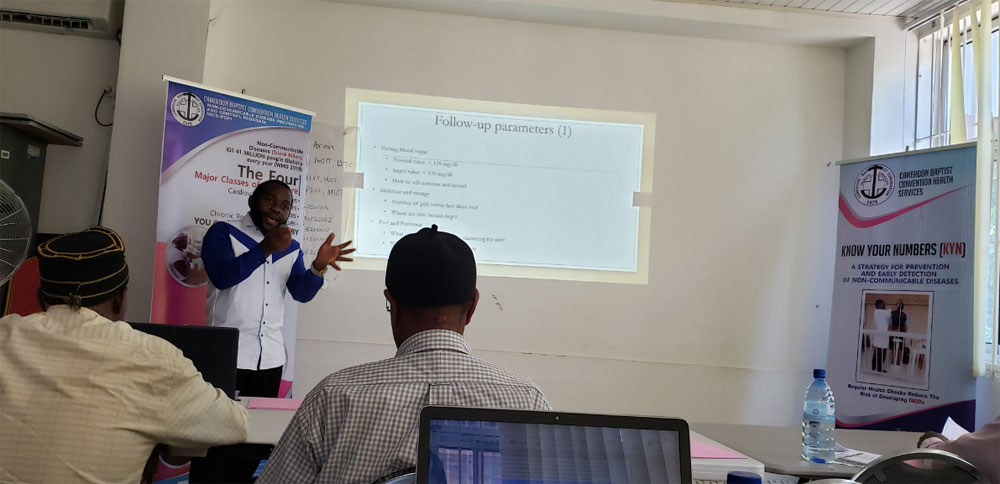 Dr. Epie Njume drilling participants on Diabetes and Hypertension follow-up parameters