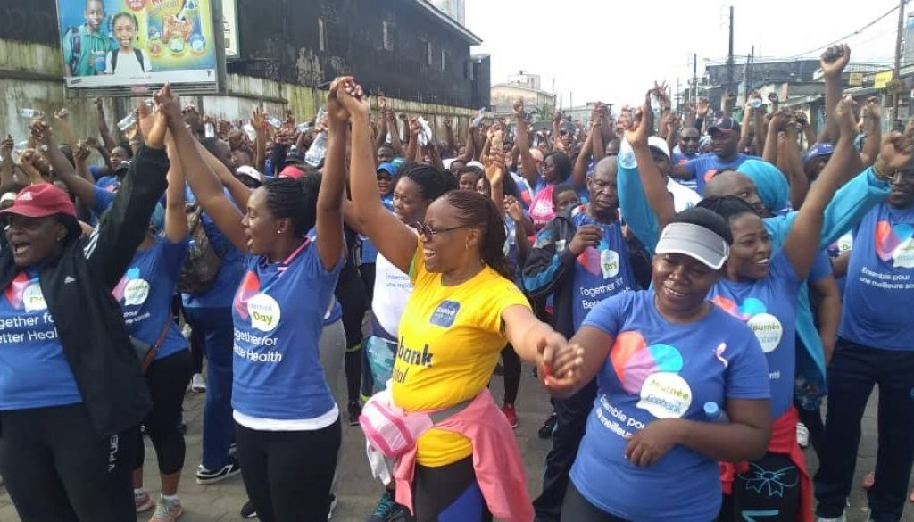Health Walk with the MD of Ecobank (right) next to the lady in Yellow Tee, championing the slogan ''Together for better Health'(1) (1)