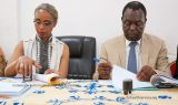 The Mayor of Foumban council (left) and Director of CBC Health Services (right) signing the MoU