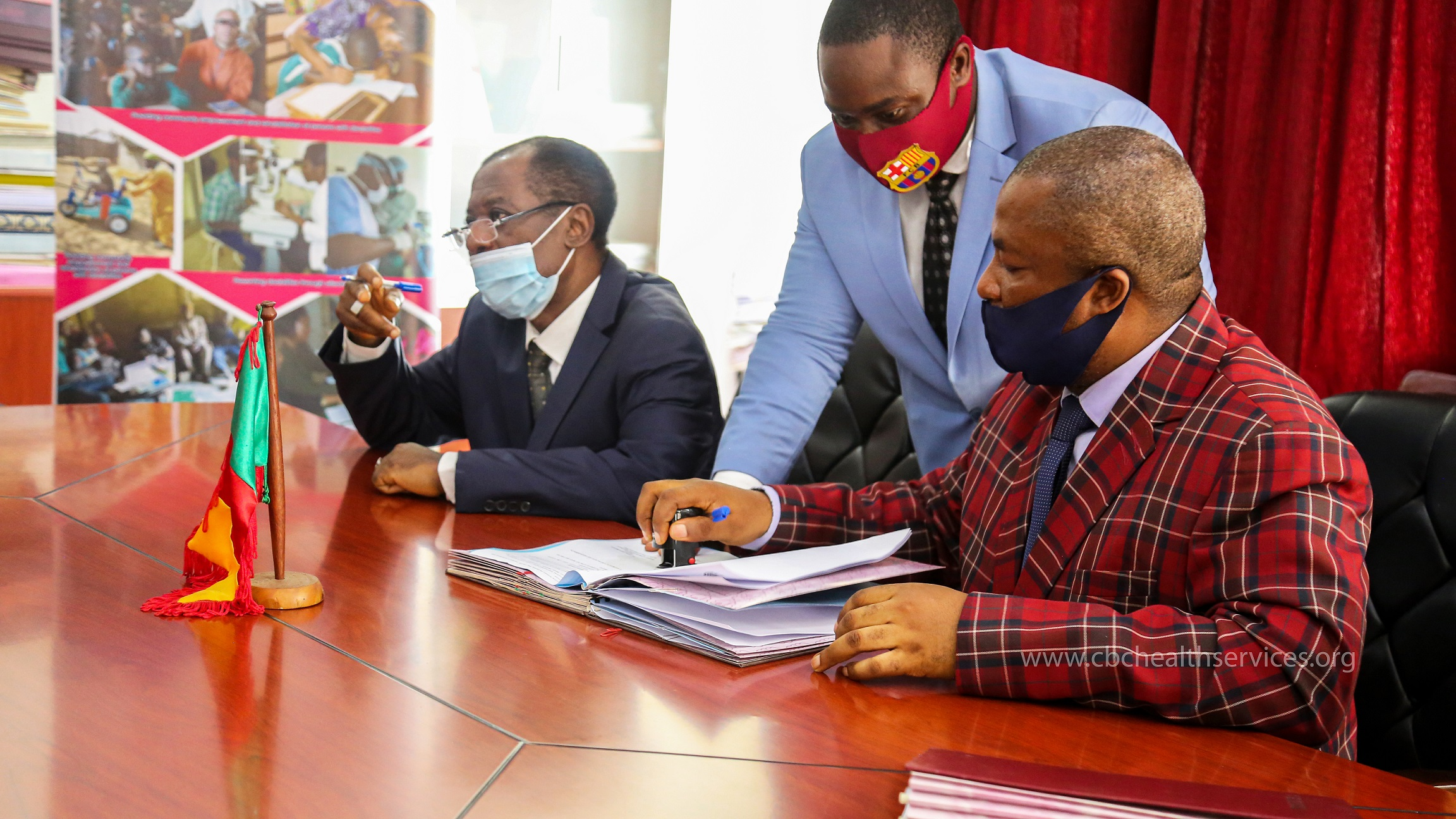 Mr Tamfu Oliver Giyo signing on behalf of the CBC Education Secretary