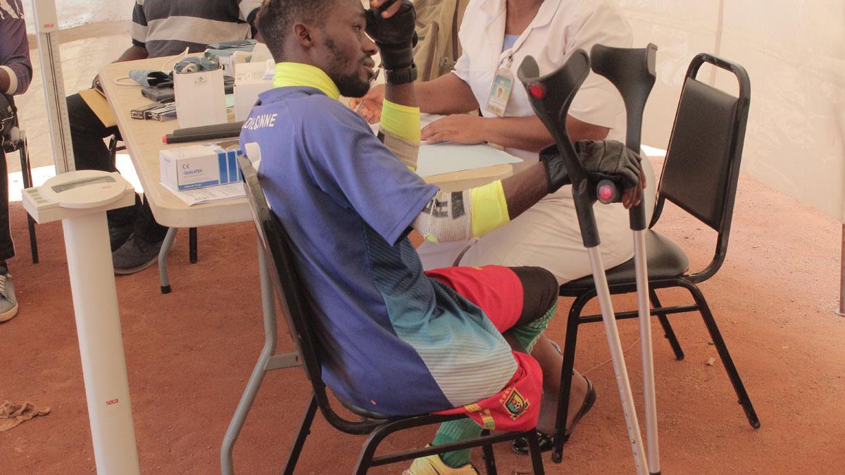 Dieudonne Fon, Think Big Amputee Football Coordinator checking his blood pressure