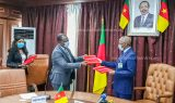 Prof Tih Pius and Dr Manaouda Malachie handing over partnership agreement