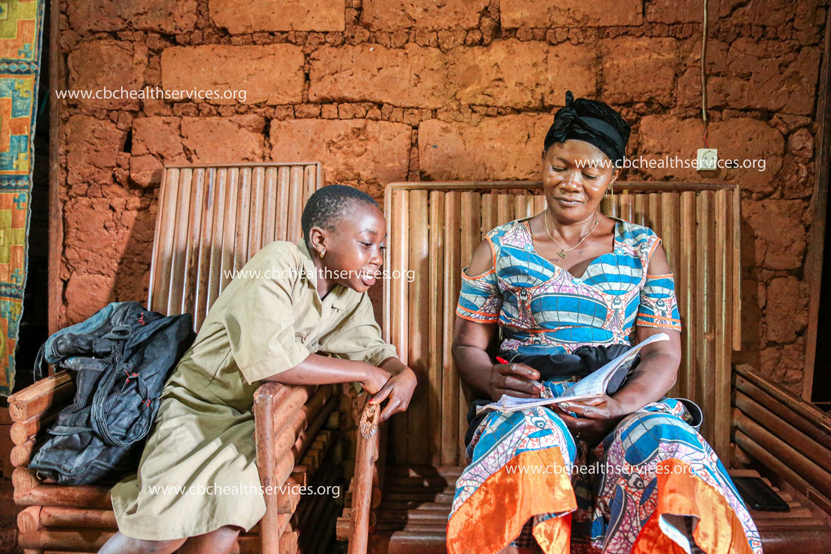 Bruneille happily learns from her grandmother, a teacher