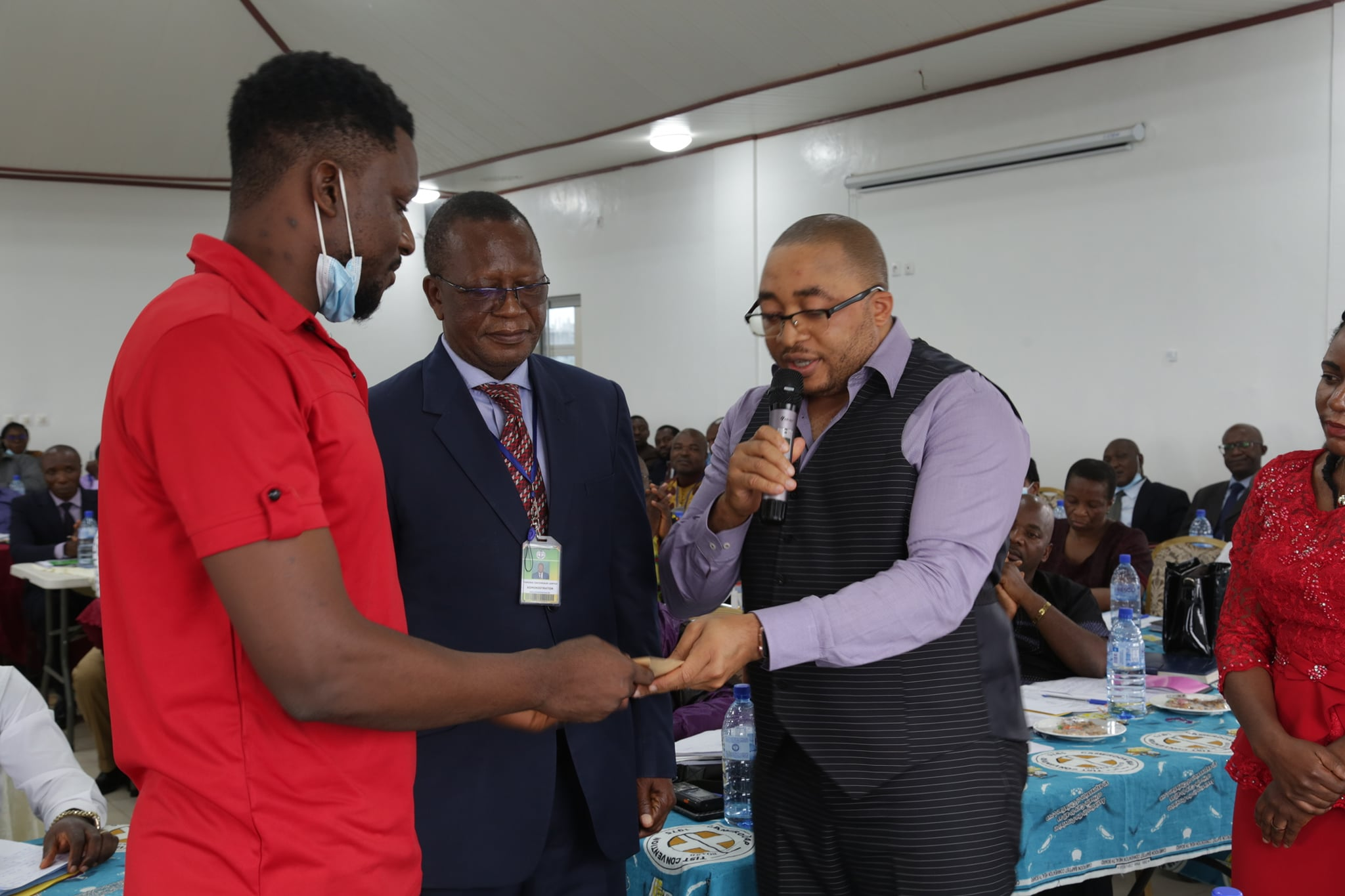 SPD Coordinator on behalf of the CBCHS hands fanacial support to the National Amputee Football team during the Chief of Centers meeting in Yaounde