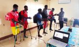 The CAF on behalf of CBCHS handing another finacial support to the Regional Amputee Football team during a meeting in Bamenda